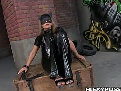 Dorothy Black is wearing a really sexy cat woman suit. She takes it off and leaves her fishnets on. Then, she fingers her ass hole and masturbates with a vibrator.