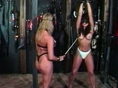 Watch a perverse blonde mistress tying up her brunette slave and using her body to entertain herself in front of a horny man. This hot lesbian bdsm game is getting wilder by the minute!