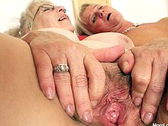 Blonde moms Alexandra and her gf are two filthy old lesbian whores. These cunts are about to fuck wildly in front of us and they love it! They start out with some kinky nipple licking and then they kiss while gaping their cunts, showing us what they have. After that one of the sluts bends over to get dildo fucked