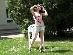 Engaging brunette chick Stacy Snake is getting naughty in the garden. She takes her miniskirt and top off and sits down in an arm chair to play with her delicious pussy.
