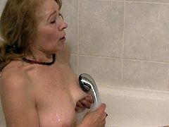 This incredibly spoiled granny knows how to make bathtime fun for everyone. She slides her fingers inside her wet muff and starts pumping them in and out until she reaches sweet orgasms.