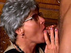 Mature bitch Matilda wearing a wig kneels in front of some dude and gives him a blowjob. Then they fuck in cowgirl and other positions on the floor and Matilda moans insanely with pleasure.