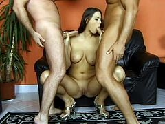 Gorgeous bitch Simony Diamond is having fun with two studs indoors. She sucks and rubs their pricks like never before and then gets double penetrated and facialed.