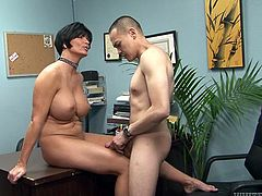 Tough mistress is sitting naked in the office. She thrusts her feet up in the air before dude's face. She orders him to suckle her toes. Submissive dude follows her orders properly.