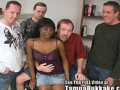 Tampa Bukkake brings you an amazing free porn video where you can see how a naughty ebony slut gets gangbanged by four white dudes while assuming very hot poses.