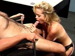 This MILF is sexy in stockings but sexier with the cock in her mouth. Look at this little whore go when she is down on her knees.