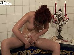 Watch this hot babe finger drilling her wet and tight pussy while taking a shower in her bathroom in Fun Movies sex clips.