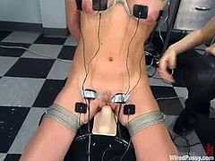 This luscious honey starts playing with her mistress's mind, showing her twat. Then she gets bondaged and forced to sit on that powerful fucking machine!