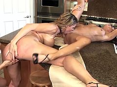 This amazing lesbian threesome has the MILFs Kayla Quinn, Michelle Lay and Savannah Jane licking pussy in the kitchen.