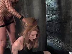 Nasty redhead chick gets her hair pulled by a mistress in fishnet bodysuit. After that she also gets toyed with a vibrator and hit with electricity.