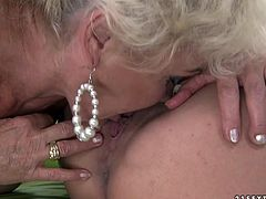 Petite blonde babe naked Lisa passionately kisses her hot lesbo granny. Young beauty gets her tight pinkish cunt licked and then treats her grandma with cunnilingus.