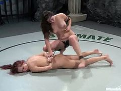 Beautiful redhead chick Smokie Flame and brunette cutie Bobbi Starr are having a wrestling match on tatami. Bobbi wins and ties Smokie up before smashing her pussy with a strapon.