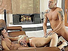 Blonde hottie Lindsey Olsen gives two men the ride of their life with her talented mouth and wet eager bald pussy