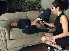 Blonde chick lies on a sofa getting toyed with a vibrator by her mistress. Later on she gets her pussy hit with electricity in a shower.
