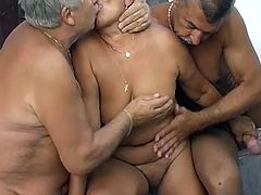 Horny chubby granny lies on couch all naked letting two geezers suck her fat tits. Old ugly hooker gives blowjobs and gets her loose snapper rubbed.