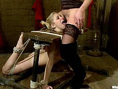 Salacious chick Felony is having fun with Penny Pax in a basement. Felony binds Penny and attaches chains to her big natural tits and then humiliates the girl and slams her vag with a strapon.