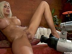 Sexy blonde milf Puma Swede is playing with a fucking machine in a living room. She explores the device first and then welcomes it in her warm depths.