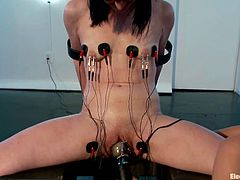 Brunette girl gets tied to a post by her mistress. After that she gets her pussy and boobs stimulated with electricity. In addition she gets her vagina toyed deep.