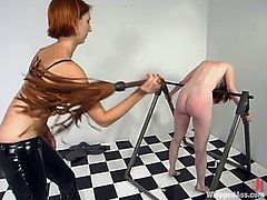 Skinny Ivy gets choked and then whipped with a stick by Kendra. Later on pigtailed Ivy also gets her tight pussy toyed.