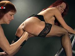 We have two experienced lesbians, Faye Rampton and Wendy Taylor, who will use big dildos and their fists to give each other pleasure.