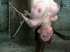 Sexy chick hangs upside down and gets her smooth pussy toyed with a vibrator. After that she tells about her love for BDSM.