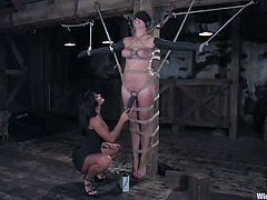 Kinky chick with big boobs gets undressed and tied up by two mistresses. Later on she gets her tits and ass shocked with electricity.