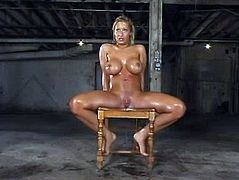 Big tittied Candy Manson gets oiled up and tortured