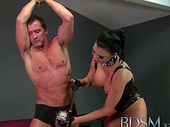 BDSM brings you an amazing free porn video where you can see how an evil brunette domme dildos and fingers her slaves' ass while flaunting her amazing body.