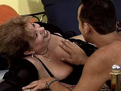 Chubby mature lady called Nancy wearing sexy stockings is having fun with some guy in a bedroom. She gives a blowjob and a handjob to the stud and then they fuck in cowgirl and other positions.