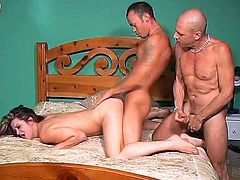Gorgeous brown-haired milf Raquel Devine is having fun with two dudes indoors. She fucks the guys' butts with a strapon and enjoys jumping on their cocks.