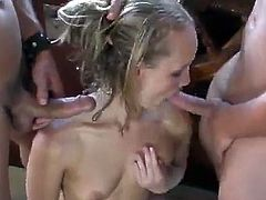 Beautiful blonde drops her bikini and inhibitions taking the Captain and his Mate and handling both their cocks at the same time like a true sea wench!