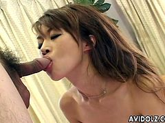 Lovely Japanese girl gets her bushy vagina fingered. After hat this babe gives an amazing blowjob standing on her knees.