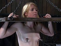 Jessie Cox and Ami Emerson take their clothes off and then put in the stocks. After that they their pussies toyed by Isis Love.
