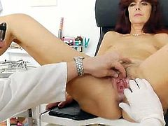 Lada is a mature hottie who is regularly going to the doctor. He controls her pussy and he asks her to pee in a bowl for further tests. She loves the whole thing.