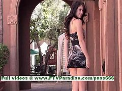 Ashlyn brunette girl with natural tits posing outdoor