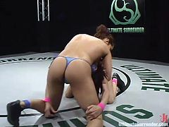 Isis Love and Tory Lane are having a struggle on tatami. They beat each other vigorously and then Isis fucks Tory's snatch with a big strapon.