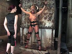 Blonde chick gets tied up with straps and tortured with clothespins. Later on she gets her pussy and ass toyed with an electric dildo in femdom video.