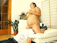 Fat Sitting brings you a nasty free porn video where you can see how a vicious BBW brunette sits on her man's face and gives head before vibrating her cunt into ecstasy.