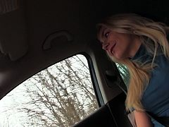 Shameless blonde chick is seduced to give a handjob in car. While dude rides the car blondie pulls his dick out of his pants and starts stroking it with her hands.