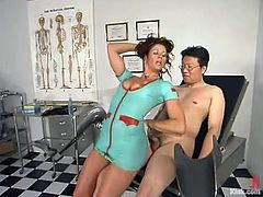 A nerd called Dave is playing dirty games with sexy nurse Kym Wilde. The guy sits down in a gynecologycal chair and lets Kym play with his prick and enjoys it when the mistress beats his butt.