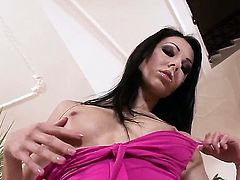 Sexy seductress Brigitte Hunter with shaved snatch makes her sexual fantasies a reality alone