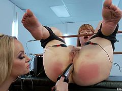 redhead slave gets her pussy electrified