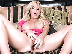 Angela Sommers touches her melons gently