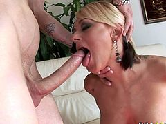 Divine blonde hoe with majestic curves Briana Blair is all naked jerks off huge dick and treats it with blowjob. Bitch shakes her huge tits while getting banged doggystyle.