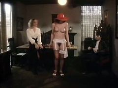 Elegant dark haired sexpot takes off her long dress and obeys her mistress. Juicy gal bends over the table exposing her big ass and gets her airy cunt rubbed by sexy blonde mommy.