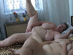 Watch this horny old granny who is in fact really fat,masturbating while she watches how her friends fucking with each other in the bed in Old Nanny sex clips.