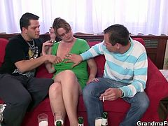 These two young guys hit on an old bitch. She massages and sucks on both their cocks and then they fuck her in the ass. She handles both like a professional.