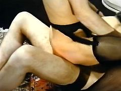 Nice looking ginger whore in tight nylon stockings and high heels shoes sits on her knees giving cunnilingus to her brunette girlfriend and then takes big cock for a ride in cowgirl pose.