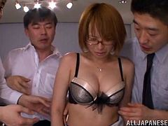 Take a look at this hot scene where the slutty Asian babe Rika Hoshimi ends up with her face covered by cum after the guys in the office play with her.