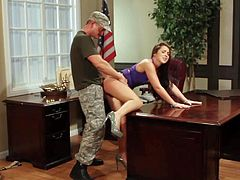 Pretty long haired brunette Lola Foxx with natural boobies and firm ass in high heels gets pounded from behind and on desk by Eric Masterson until he sprays her with cum.